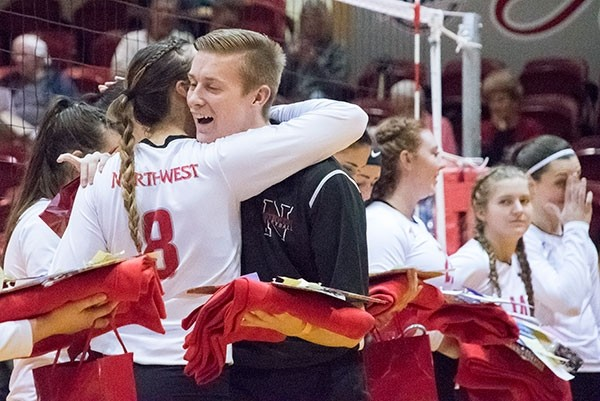 Northwest College student assistant Nyckalas Harvey receives a hug from Lady Trapper Ashley Uffelman during Sophomore Night festivities in October. Harvey will fulfill his dream of playing collegiate volleyball this spring at Missouri Valley College.