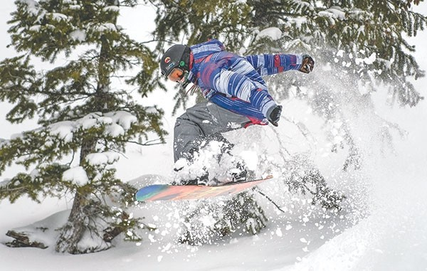 Perry Brown shreds through fresh powder on his snowboard at Sleeping Giant Ski Area Wednesday. The slopes opened late this year, but now have more than an 18-inch base.