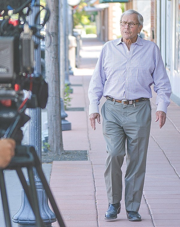 Today Show correspondent Tom Brokaw is filmed as he strolls through downtown Powell last July. The veteran newsman was in town filming a story about conservative rural America.