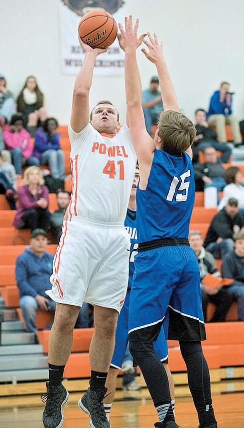 Powell High School junior Carson Heinen goes up for two points against the Lovell Bulldogs last week.