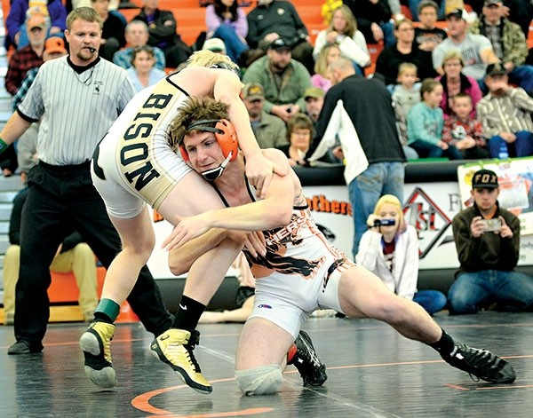 Powell High School junior Reese Karst wrestles against Hunter Elmer during the 138-pound weight class championship match at the Powell Athletic Roundtable Invitational on Saturday. Karst was voted as the Outstanding Varsity Wrestler of the tournament.