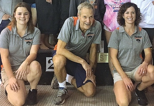 Head coach Bob Smartt (center) sits alongside assistant coaches Bailey Jackson (left) and Heather Christensen at the 3A State Swim and Dive Championships in Gillette on Friday.