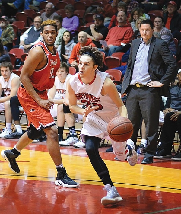 Trappers shooting guard Tanner Coleman drives the lane in a game against Casper College last season as head coach Brian Erickson looks on. Coleman, a Deaver native, has been named a captain for the 2017-18 season.