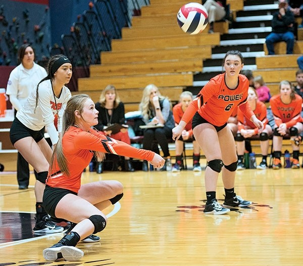 Powell High School senior Aubrie Stenerson goes for a dig while teammates Jordan Walsh (No. 6) and Natalie Birdsley (in white) watch intently during a Saturday morning game against Pinedale at the 3A West Regional volleyball tournament in Riverton.