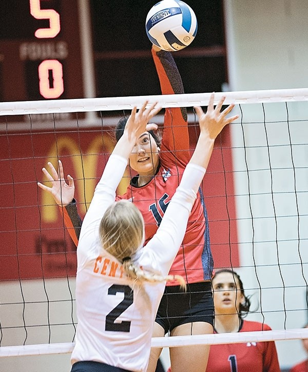 Lady Trappers outside hitter Elena Takova spikes the ball over Central Wyoming's Alyssa Barkhurst Friday night at Cabre Gym. NWC swept the Rustlers in three games, 25-21, 25-17 and 25-22.