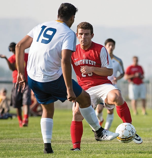 Trappers midfielder Sergio Santamarina defends against Western Nebraska's Leo Palomo in a game at Trapper Field earlier this season. NWC lost to the Cougars Saturday 5-1 in the opening round of the Region IX playoffs in Scottsbluff.