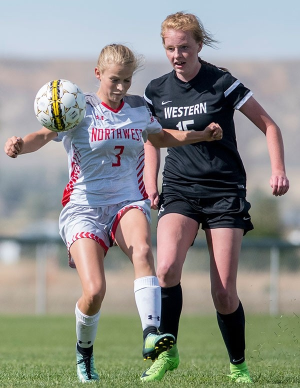 Lady Trappers midfielder Kayla Atkinson battles for the ball against Western Wyoming's Maylee Thompson during a game at Trapper Field last month. The Lady Mustangs swept the season series with a 2-0 win over NWC in Rock Springs on Oct. 11.