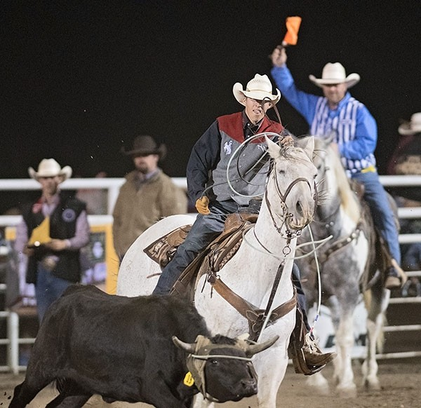 Trapper team roper Dawson Cvancara completes a successful head catch during the Trapper Rodeo last month at Cody Stampede Park. Heeler Jake Griffel (not in photo) missed a leg on this run for a penalty time of 23.1 seconds. The duo is currently sitting in sixth place in the Big Sky Region.