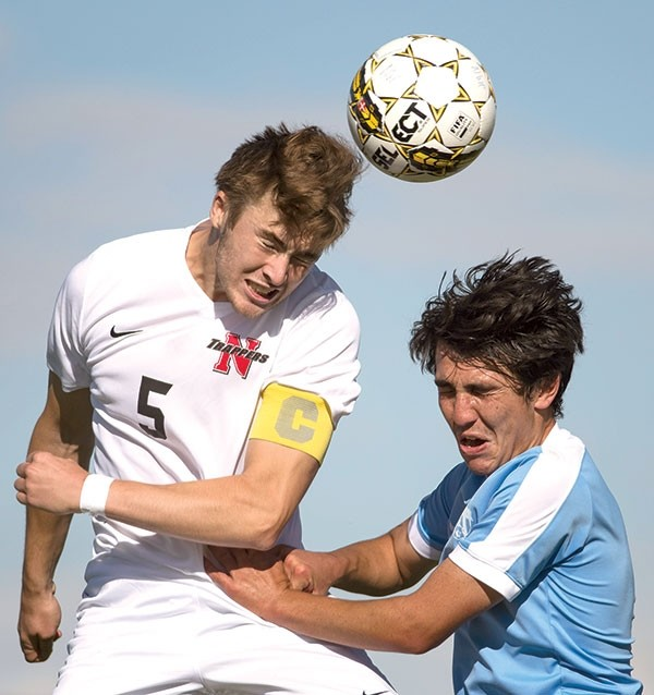 Trapper captain Ryan Tyrer battles for possession against a Sheridan College defender last week at Trapper Field. The Trappers downed the Generals, 3-1.