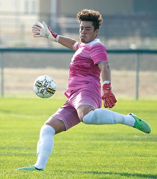 Trapper keeper Luke Holt clears the ball against Western Nebraska Community College in a game earlier this season. The Scotland native has brought a strong work ethic and a level of professionalism, as well as a sense of humor, to the NWC soccer program.