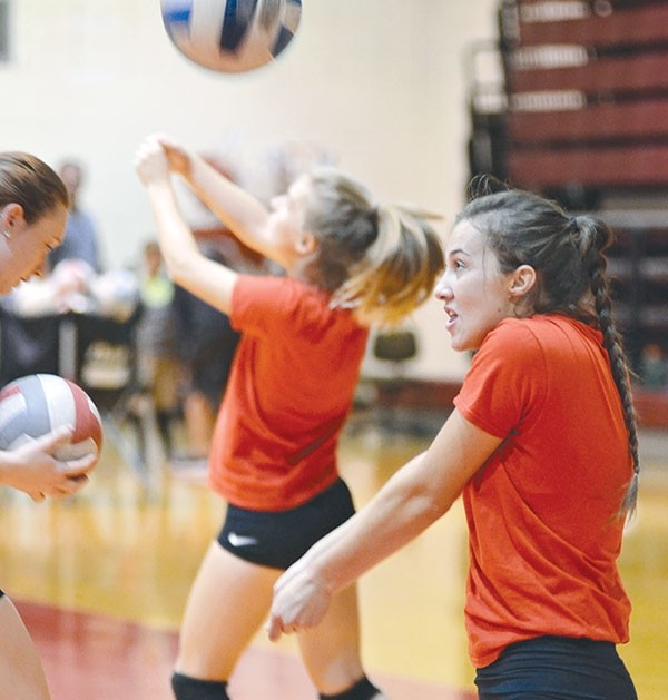 Northwest College freshman Demery Dean from Nampa, Idaho, passes the ball to herself during a serve/pass warm-up drill during Wednesday's morning practice.