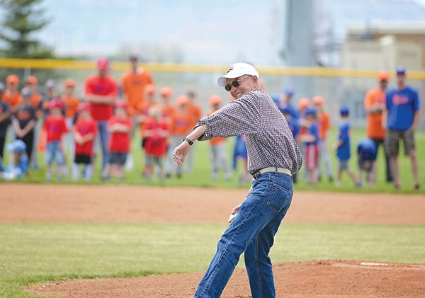 Gary Hatmaker throws the opening ceremony pitch for the Powell Pioneers on May 6. Hatmaker has been coaching Little League baseball for 50 years.