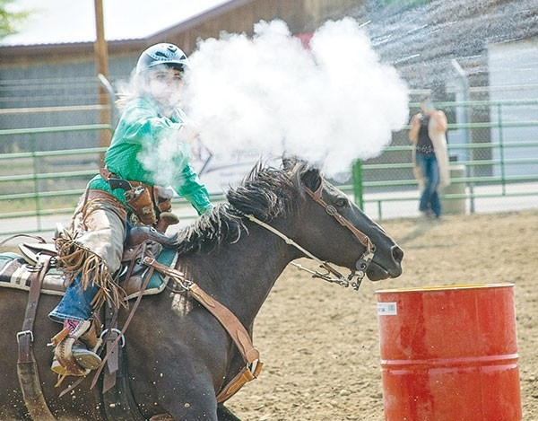 Dacean Thomas of the Wyoming Desperados Mounted Shooters Club blasts a balloon en route to a first place finish in the ladies level one division at the 2017 CMSA Wyoming State Championship Saturday at the Park County Fairgrounds. Thomas was also presented the Comeback Kid Award after recovering from a riding accident last summer.