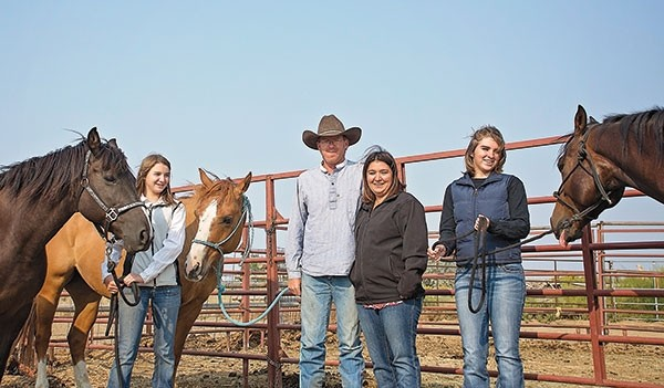 The Thomas family gathers at their ranch outside of Deaver Wednesday morning. Jason Thomas and his daughters Dacean and Gabby will be competing this weekend in the Battle in the Basin 2017 CMSA Wyoming State Mounted Shooting Championship. From left: Gabby, Jason, Darby and Dacean Thomas, with horses Bug, Catty and Jeffrey.