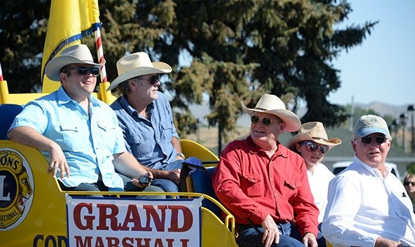 "Craig Johnson (second from right), author of the Longmire series of books, rides in the grand marshal truck along with TV series stars Adam Bartlett (left) and Robert Taylor (second from left), during the Cody Stampede Fourth of July Parade last month. The 13th novel in the Longmire series, ""The Western Star,"" hits shelves in September."
