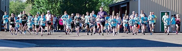 The 88 participants who competed in the sixth annual Dano'lope' Dash 5K/10k and 1 mile run/walk take off from the starting line on Saturday at the Park County Fairgrounds.
