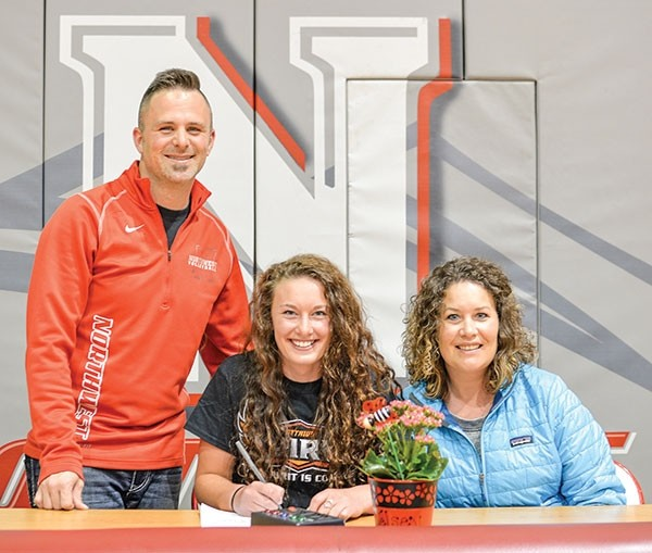 Kelsey Marchant signs her letter of intent on May 17 to play for Ottawa University in Surprise, Arizona, alongside Northwest College head volleyball coach Shaun Pohlman and mom Amanda Marchant.