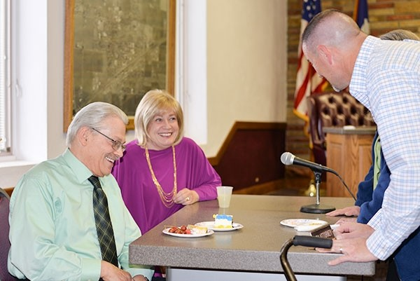 Powell Municipal Court Judge Jim Allison (left) shares a laugh with his wife Christie and Powell Police Sgt. Matt McCaslin at a Thursday reception in his honor at City Hall. Allison and Municipal Court Clerk Joy Ness are retiring from their court positions this week.