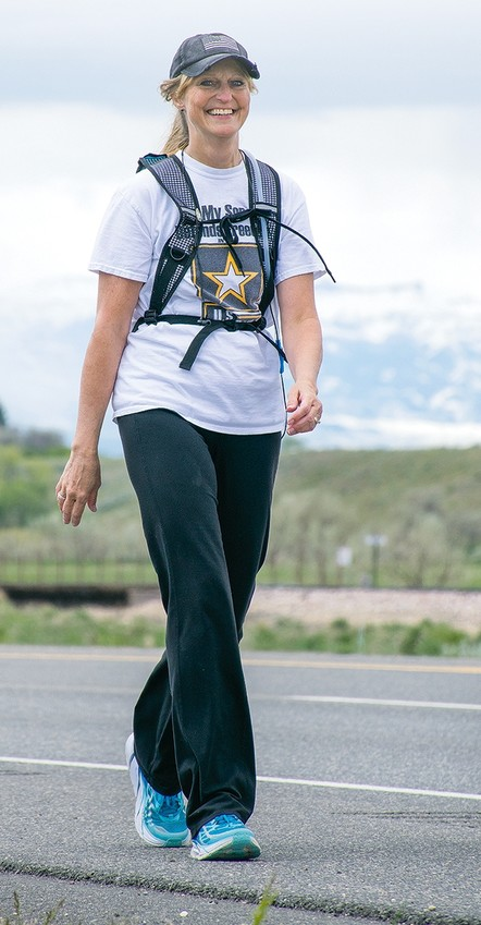 Terresa Humphries-Wadsworth walks from Cody to Powell on Saturday in honor of Armed Forces Day. In September, she will walk from the Wyoming Veterans Memorial Park in Cody to the Wyoming State Capitol Building in Cheyenne — over 400 miles in 15 days — to raise awareness for suicide prevention.