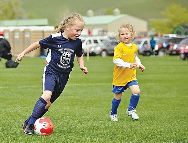 Charlie Eastman of the U8 girls team dribbles the ball at the Snickers Cup in Sheridan May 13-14.