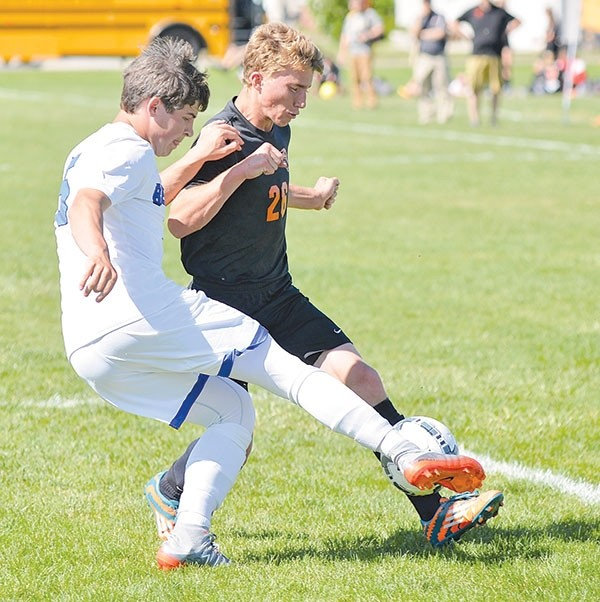Powell High School sophomore Jeremy Herd fights off a Douglas defender during Friday's state championship play-in game in Worland.