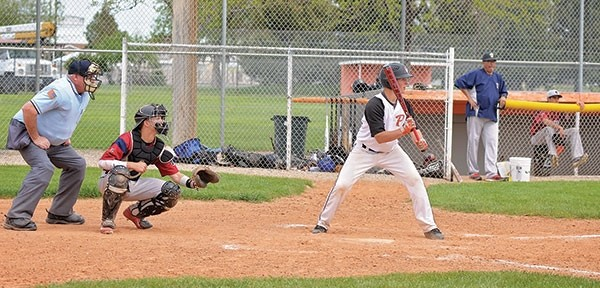 Pioneer Riley Meyer shows bunt in the second game of a double header against the Billings Halos at home on Sunday.