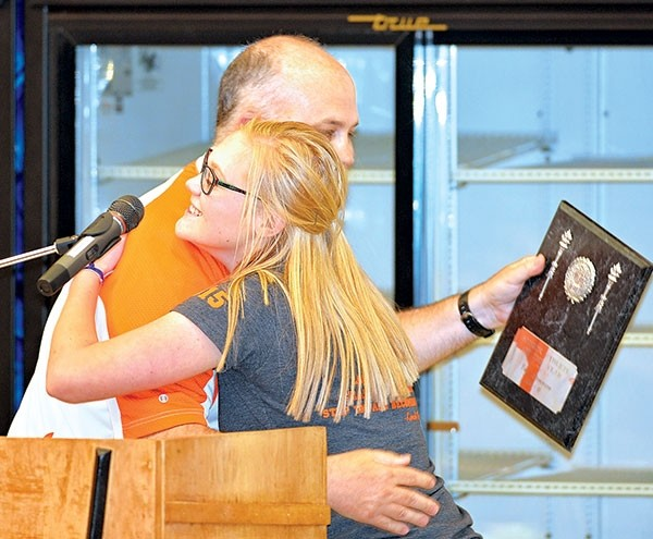 PHS girls head basketball coach Scott McKenzie gives a congratulatory hug to senior Tayli Stenerson at last week's Athletics Awards Night. Stenerson was named Senior Athlete of the Year, along with TJ Abraham.