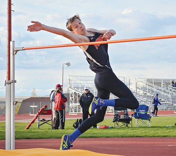 Colby Warner leaps to clear the bar during the high jump competition at last week's Track Classic in Casper. Warner finished sixth.