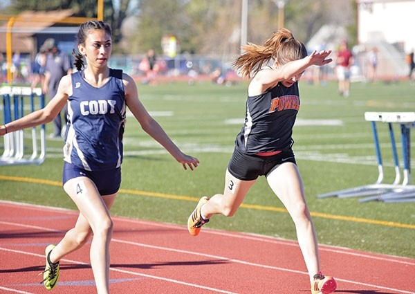 Powell High School freshman Kady Wells leans to a runner-up finish in the 200 meter dash during Thursday's Northern Wyoming Ophthalmology Trackstravaganza in Cody.
