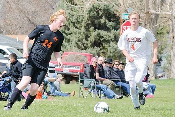 Jace Smith (black) makes a move toward the ball during a Saturday loss to Worland.