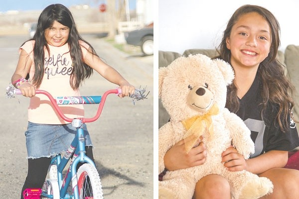 At left, Anai Torres is all smiles as she gets ready to ride her new bike. Anai was disappointed when her number wasn't picked in a drawing for a new bicycle at Saturday's Easter egg hunt at the fairgrounds, but she ended up a winner after all when Kyla Del Bosque spontaneously gave her the bike she won. At right, Kyla Del Bosque poses with the teddy bear she received from Anai Torres.