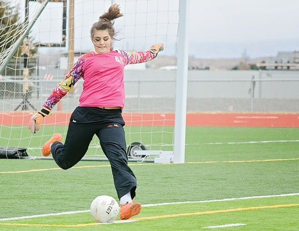 Goalie Sydney Olsen boots the ball in a home game against Worland on March 25.