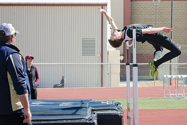Charlie Hall competes in the high jump during a track meet in Cody on Saturday. Hall leapt to a third place finish at 5 feet, 10 inches.