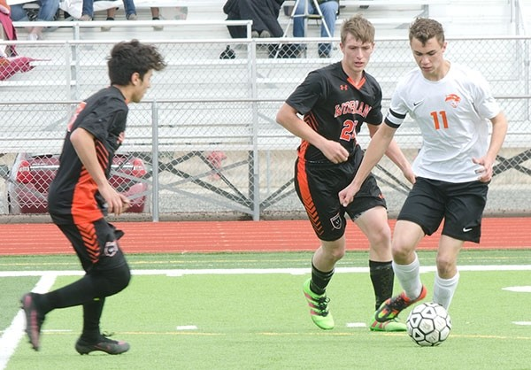 Owen Dent dribbles the ball in a home game against Worland on March 25. Against Riverton on Saturday, Dent had six shots from outside the 18-yard line and five corner kicks.