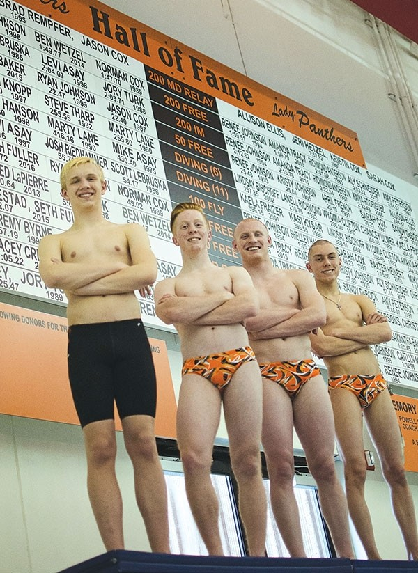 Richard Spann, Hudson Wilkerson, Nate MaGill and Kacey Creed stand in front of the Hall of Fame Board where their names will be added for breaking six school records throughout the 2016-17 swim season. The Hall of Fame Board is located at the Powell Aquatic Center.