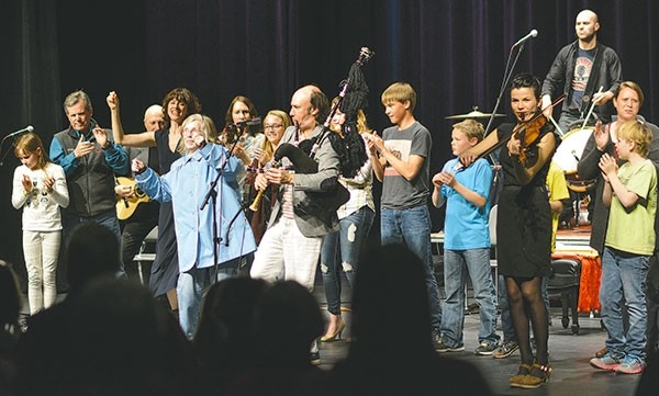Local residents join Carlos Núñez and his band on stage at the Powell High School Auditorium Tuesday night. The performance was brought to Powell by the Park County Arts Council, a local nonprofit that faces potential funding cuts under President Donald Trump's proposal to eliminate the National Endowment for the Arts.