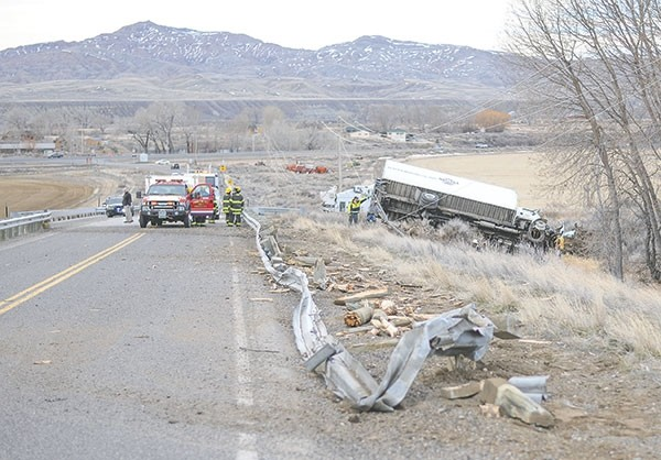 Members of the Powell Volunteer Fire Department and other emergency responders work the scene of a one-vehicle rollover on Wyo. Highway 294 Wednesday morning.