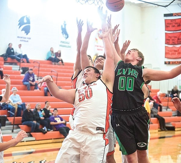 PHS junior Max Gallagher, along with Panther teammates, goes up for a rebound in a game early this season against Lander.