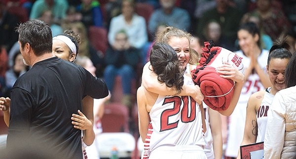 Trapper sophomores were honored last Wednesday following their win against Central Wyoming at Cabre Gym. Sophomore Maddy Johnson (No. 20) receives a hug from teammate Kira Marlow.