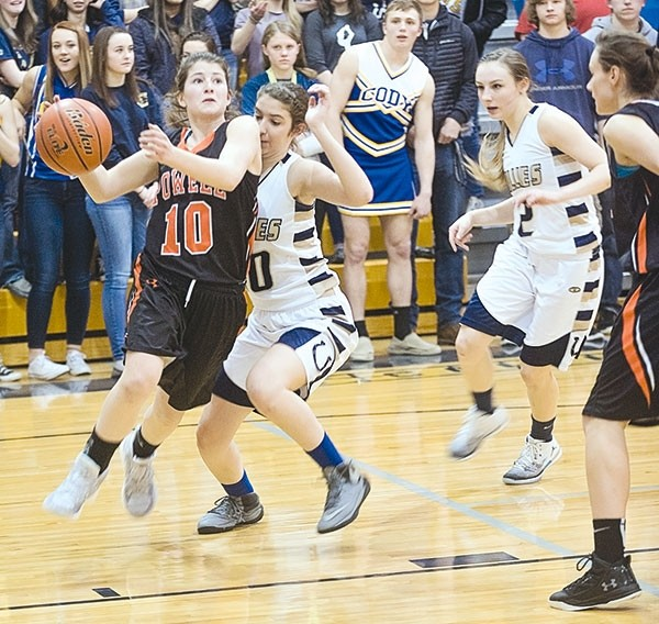 PHS junior Maddy Hanks drives past a Cody Filly to the basket in Friday's 38-36 OT win in Cody.