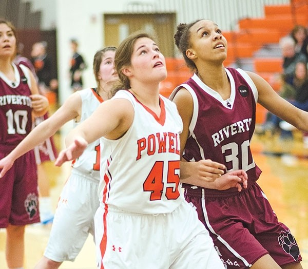 Jasmyne Lensegrav fights for rebounding position after a free throw in a home game against Riverton on Saturday.