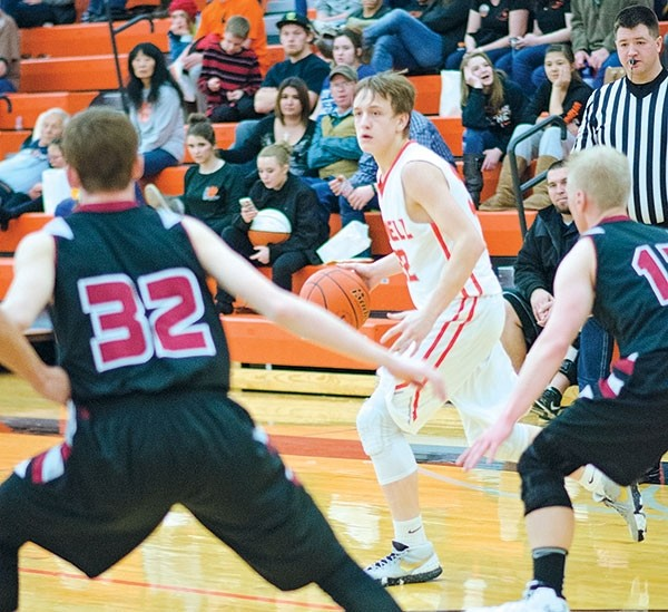 PHS sophomore William Preator dribbles the ball while looking for an opening inside the paint during a home game against Riverton on Saturday.
