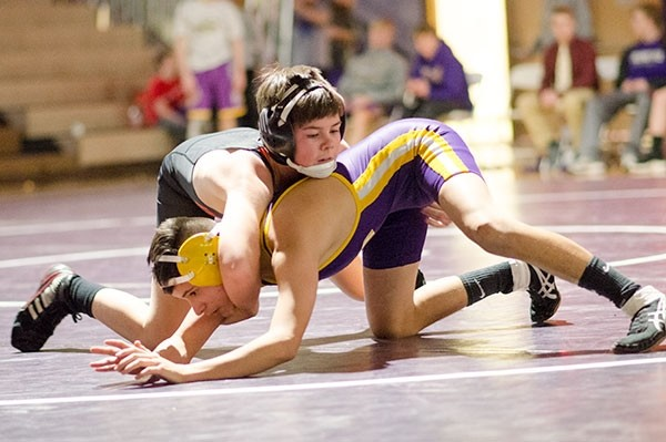 Powell freshman Zane Cordes wrestles in the 106-pound weight class during the dual in Laurel, Montana, on Jan. 17. Cordes pinned his opponent in the third period.