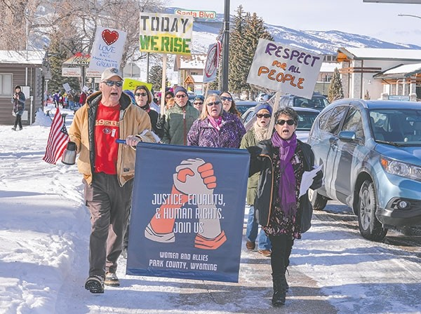 Larry and Karen Parker of Powell lead a group of demonstrators around Cody City Park during the Park County Women and Allies March Saturday. The event drew around 500 participants and was held in conjunction with the Women's March on Washington.