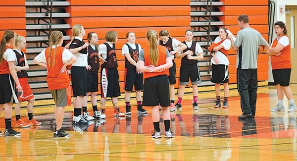 Panther freshman coach Gary Phister assigns players to orange, black and white teams for a practice drill during Tuesday night's practice.