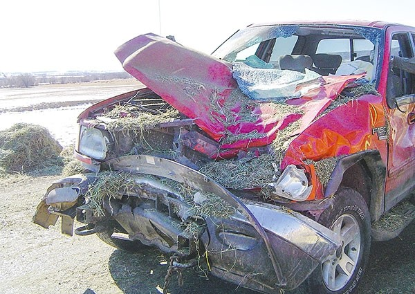 Richard and Bill Schlenker's truck looked like this after being hit by hay bales in 2010.