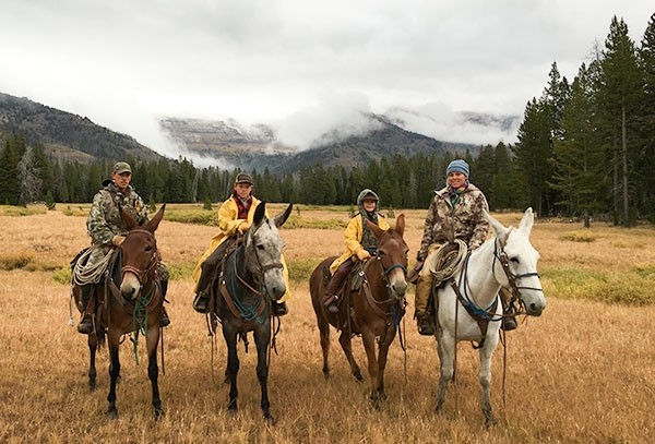 Colby, Caden, Casen and Codi Gines sit on mules while in the Wyoming backcountry during a hunting trip.