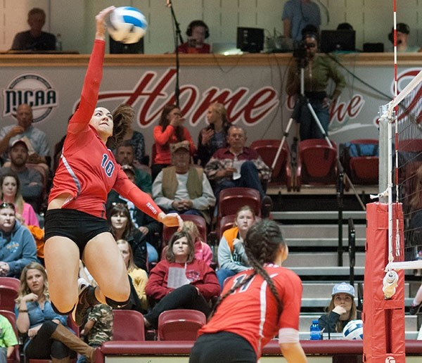 NWC sophomore Lauga Gauta spikes the ball during a home game against Western Wyoming Community College. Gauta was named a Division I First Team All-American by the NJCAA this month.