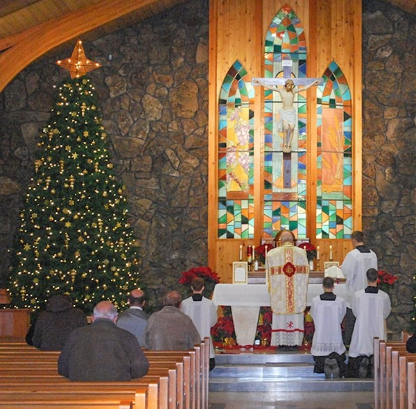 Christmas Day Mass is celebrated at St. Barbara's Catholic Church in this file photo. Local churches will host Christmas Eve and Christmas Day services this week.
