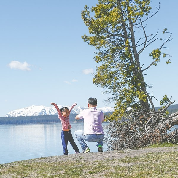 Visitors who were surveyed this summer gave the area a thumbs up. This father and daughter appeared to be enjoying their trip at Yellowstone Lake in June.